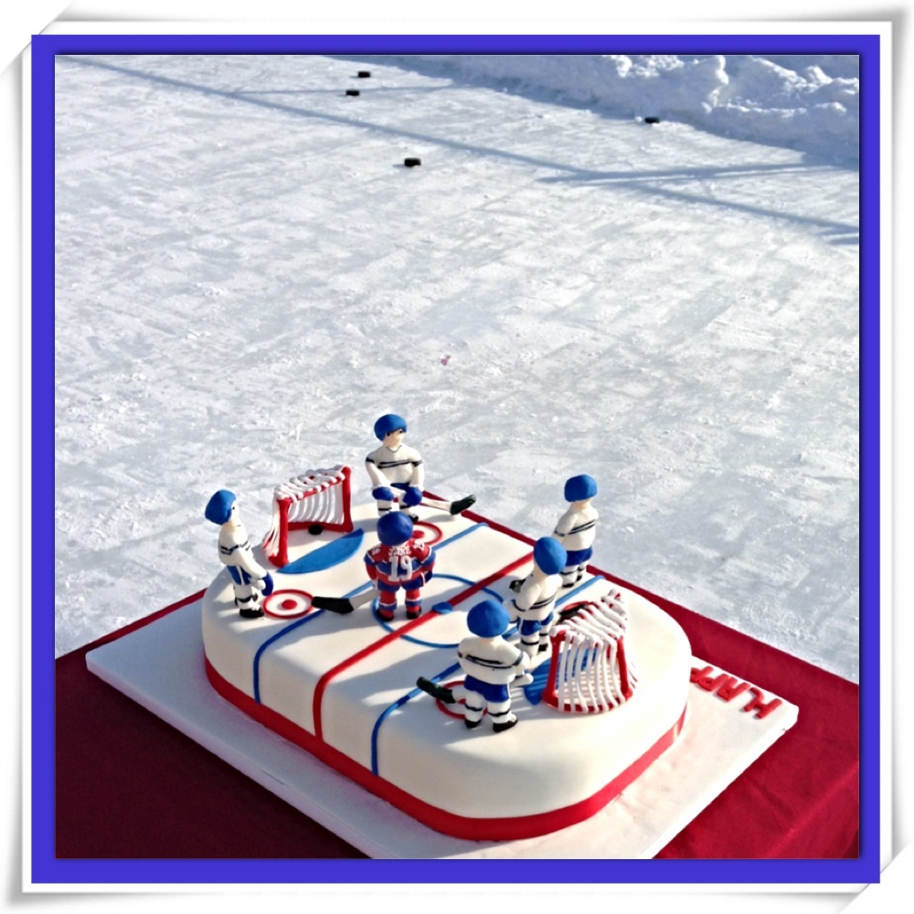 Hockey rink cake with hockey players