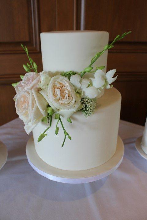 white wedding cake with fresh flowers
